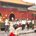 People praying at the Lama Temple